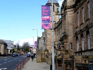raised lamppost banner for hamilton local shop